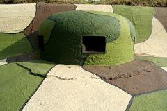 War shelter. Old painted defense shelter with shooting holes Royalty Free Stock Photo