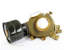 War sign. Gas mask from ww2. Used vintage green and black gas mask can illustrate danger, war, catastrophe, or other concept. Gas. War sign. Gas mask from ww2 Stock Image