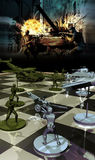 War strategies. Chessboard with war pieces, concept presentation of combat and war strategies, with war scene at the foreground Royalty Free Stock Photo
