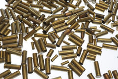 War symbols. Used empty old bullet cartridges Royalty Free Stock Image