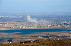 War in Syria. Explosions from the war in Syria can be seen from a hill on the Golan Heights 150 meter from the border, about 10 kilometers south/south-east of stock images