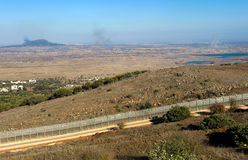 War in Syria. Explosions from the war in Syria can be seen from a hill on the Golan Heights 150 meter from the border, about 10 kilometers south/south-east of royalty free stock images
