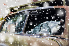 War truck with broken windshield glass over snow Stock Photos