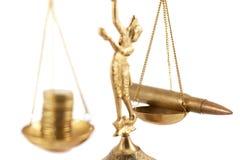 War versus money on the pan scales Stock Photo