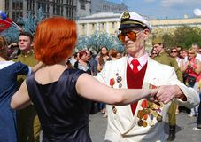 War veteran dances with a woman Royalty Free Stock Photo