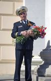 War veteran man portrait. He holds flowers. Stock Photo