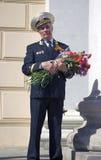 War veteran man portrait. He holds flowers. Stock Photo