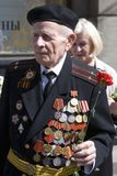 War veteran man portrait. He holds a red carnation. Royalty Free Stock Images