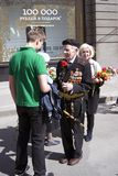War veteran man portrait. He receives flowers from a young man. Stock Images