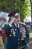 War veteran man portrait. He salutes. Royalty Free Stock Photo
