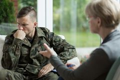 War veteran with problems. War veteran talking about problems during therapy royalty free stock photography
