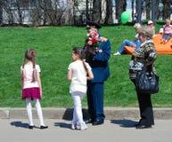 War veteran receives flowers from girls Royalty Free Stock Image