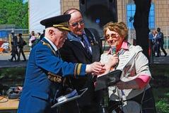 A war veteran receives a present Royalty Free Stock Photos