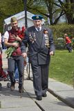 War veteran - serior man and yound man walking in a a park. Stock Image