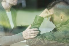 War veteran with stress disorder. Picture of psychiatrist and war veteran with stress disorder Royalty Free Stock Image