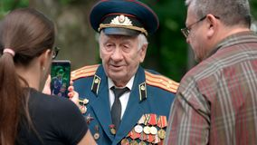 War veteran in uniform. 09.05.2018 - Kyiv, Ukraine. War veteran in uniform with different medals and awards. Elderly colonel general of Second World War. Great stock photography