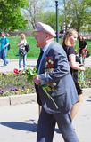 War veteran walks with flowers Stock Photo