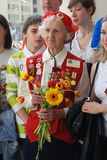 A war veteran woman holding flowers. Royalty Free Stock Photo