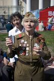 War veteran woman portrait. She makes a speach. MOSCOW - MAY 09, 2015: War veteran woman portrait. She makes a speach. Victory Day celebration in Moscow Stock Images