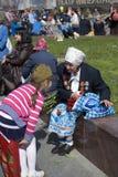 War veteran woman speaks to a girl. Royalty Free Stock Photos