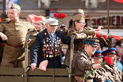 War veteran and young people in uniform Royalty Free Stock Image