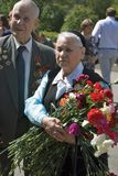 War veterans couple holding flowers. Royalty Free Stock Photo