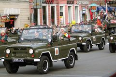 War veterans greeting public from cars. Stock Images
