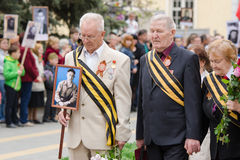 War veterans are at a monument to the fallen wars Stock Image