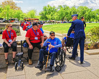 War veterans in National Mall in Washington DC. Washington DC, USA - May 2, 2015: War Veterans and guardians of Honor Flight non-profit organization in the Stock Images