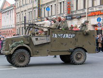 War veterans in old car at a military parade Stock Photos