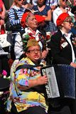 War veterans sing songs. A woman plays accordion. MOSCOW - MAY 09, 2014: War veterans sing songs. A woman plays accordion. Victory Day celebration in Moscow Royalty Free Stock Photography