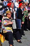 War veterans sing war songs. A woman plays accordeon. Stock Photos