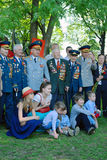 War veterans and their families pose for photos. Stock Photography