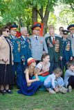 War veterans and their families pose for photos. MOSCOW - MAY 09, 2016: War veterans and their families pose for photos.  Victory Day celebration in Gorky park Royalty Free Stock Photos
