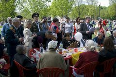 War veterans and their relatives celebrate Victory Day in Gorki park. Stock Image
