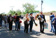 War veterans walk in Gorky park. Royalty Free Stock Photos