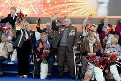 War veterans welcome the participants of the action `Immortal regiment` on the red square of Moscow. Royalty Free Stock Photography