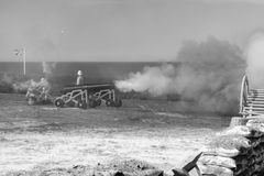 The War from the Victorian Era. Cannon crew firing an old cannon from the Victorian Era. Photo in black and white. The simulation was held in the Fort Rinella stock photo