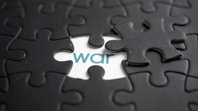 War. Word war under jigsaw puzzle piece royalty free stock image