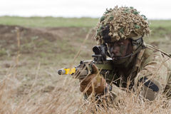 War zone with sniper soldier. Over 4500 troops take part in the NATO `Wind Spring 15` military exercise at Smardan military shooting range on April 22, 2015 Stock Photos