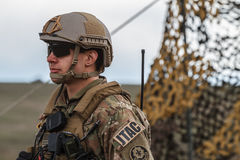 War zone with soldiers. Over 4500 troops take part in the NATO `Wind Spring 15` military exercise at Smardan military shooting range on April 22, 2015 royalty free stock photos