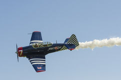 Warbird Harvard with smoke Stock Images