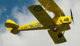 Warbirds - Yellow Tiger Moth in flight Royalty Free Stock Photography
