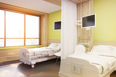 Ward with two beds, yellow, side, toned Stock Photography