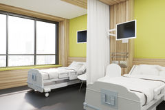 Ward with two beds, yellow, side view Stock Image