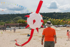 A warden and a huge morningstar kite. Stock Photography