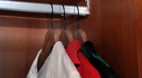 Wardrobe. With three shirts on hangers Stock Image