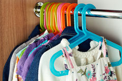 Wardrobe with baby сlothes Royalty Free Stock Photos