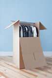 Wardrobe box with clothing, ready for moving Stock Image