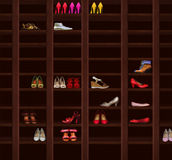 Wardrobe. Brown Wood Shelves with Women's Shoes. Fashion Royalty Free Stock Photo